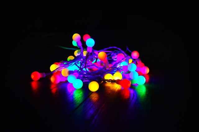 assorted color string lights on dark room